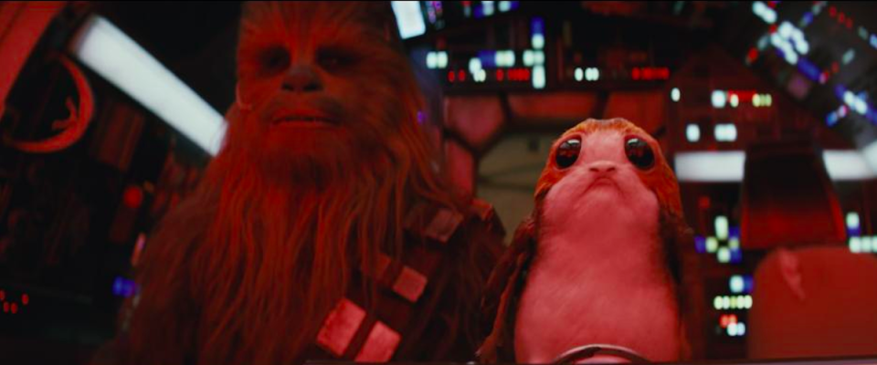 <p>Another of the island's inhabitants are the penguin-like porgs, one of which is seen here with Chewbacca (Peter Mayhew).<br>(Credit: Lucasfilm) </p>