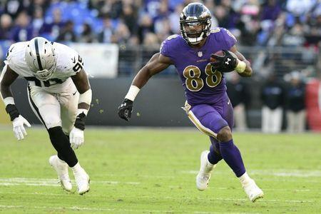 FILE PHOTO: Nov 25, 2018; Baltimore, MD, USA; Baltimore Ravens running back Ty Montgomery (88) rushes by Oakland Raiders defensive end Fadol Brown (95) during the fourth quarter at M&T Bank Stadium. Mandatory Credit: Tommy Gilligan-USA TODAY Sports