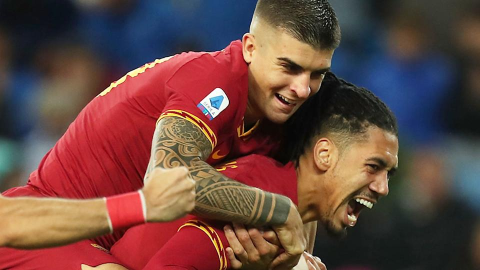 Seen here, Chris Smalling celebrates with a Roma teammate during a football match.