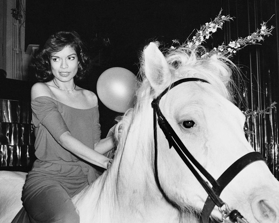<p>Bianca Jagger rides in on a white horse at during her birthday celebrations at Studio 54 in New York, May 1977.</p>