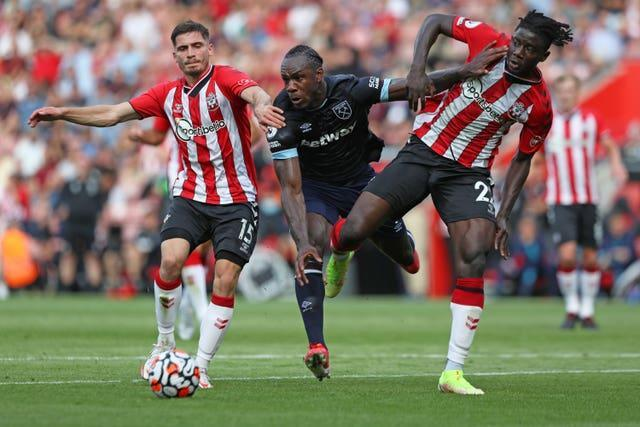 Michail Antonio, centre, battles for possession with Mohammed Salisu, right, and Romain Perraud