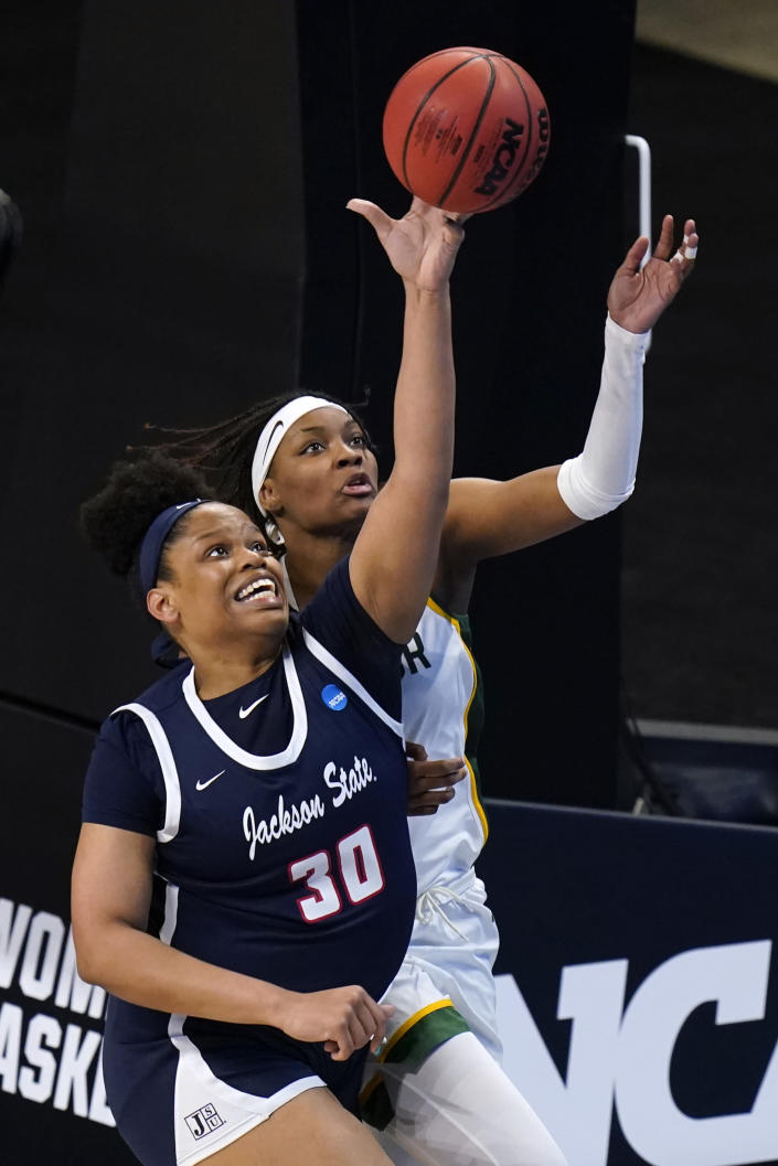 Jackson State center Diamond Forrest (30) fights for a rebound with Baylor forward NaLyssa Smith during the second half of a college basketball game in the first round of the women's NCAA tournament at the Alamodome, Sunday, March 21, 2021, in San Antonio. (AP Photo/Eric Gay)