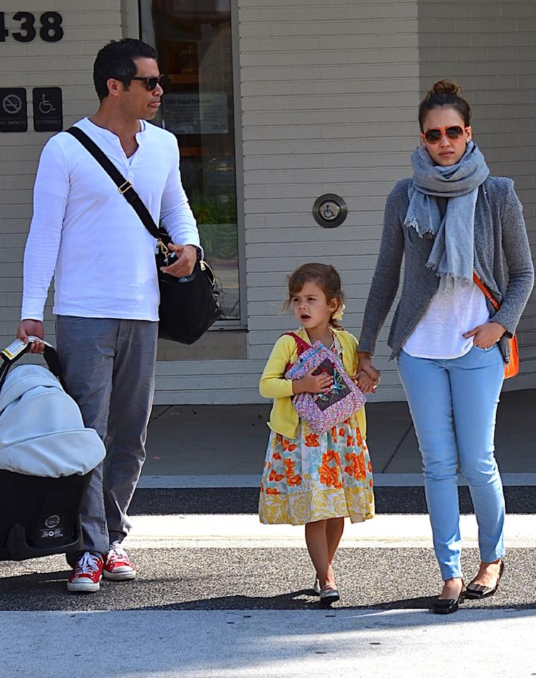 Jessica Alba dressed for a casual day with the fam, which included hubby Cash Warren, and daughters Haven, 7 months, and Honor, 3. The gang enjoyed breakfast at Beverly Hills eatery Nate & Al's, which included Easter baskets for the girls. (4/8/2012)