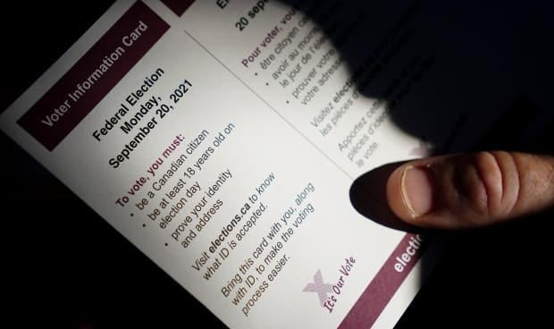 A person holds an Elections Canada voter information card after receiving it in the mail on Tuesday, Aug 31, 2021. Faelan Quinn said it was jarring to see their dead name on their card after they had legally changed it. (Sean Kilpatrick/The Canadian Press - image credit)