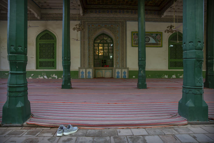 A pair of shoes sits near an outdoor prayer area at the Id Kah Mosque in Kashgar in western China's Xinjiang Uyghur Autonomous Region, as seen during a government organized visit for foreign journalists on April 19, 2021. Under the weight of official policies, the future of Islam appears precarious in Xinjiang, a remote region facing Central Asia in China's northwest corner. Outside observers say scores of mosques have been demolished, which Beijing denies, and locals say the number of worshippers is on the decline. (AP Photo/Mark Schiefelbein)