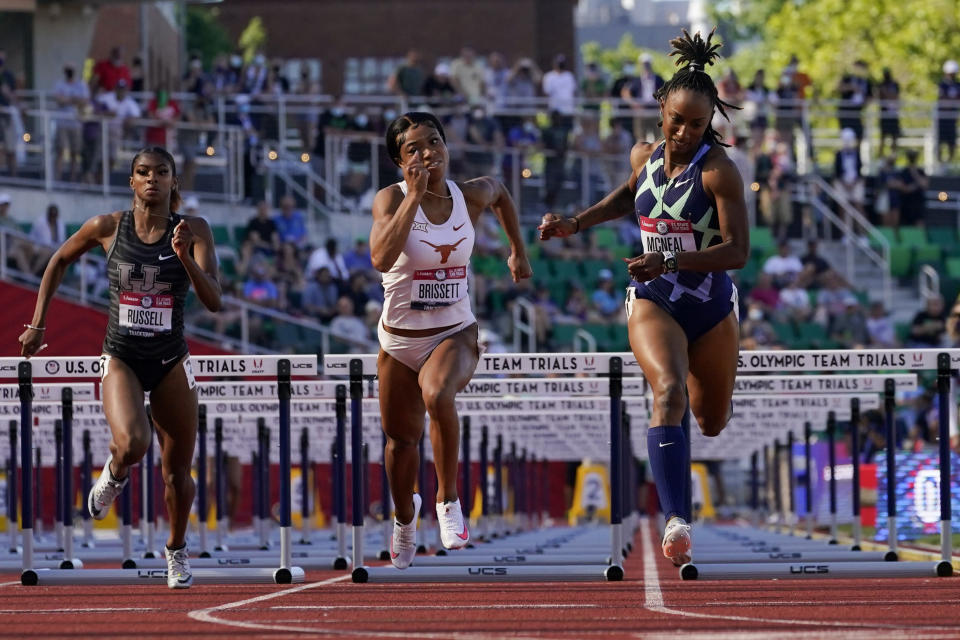 Anna Cockrell, right, wins the fourth heat of the women's 100-meter hurdles at the U.S. Olympic Track and Field Trials Saturday, June 19, 2021, in Eugene, Ore. (AP Photo/Ashley Landis)