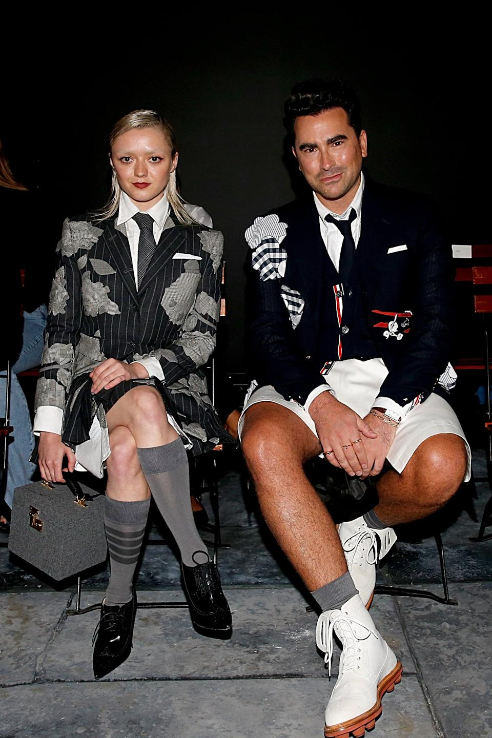 """<p><a class=""""link rapid-noclick-resp"""" href=""""https://www.popsugar.com/Dan-Levy"""" rel=""""nofollow noopener"""" target=""""_blank"""" data-ylk=""""slk:Dan Levy"""">Dan Levy</a> sat front row at the Thom Browne show during NYFW in a navy embellished vest and crisp white skort. As a close friend of Thom Browne, actor Dan Levy often goes for the designer's sharp suits for his glamorous events.</p>"""