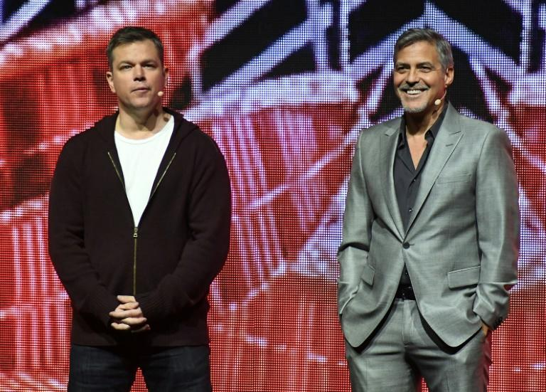 Actors Matt Damon (L) and George Clooney speak onstage at CinemaCon 2017 Paramount Pictures Presentation, at Caesars Palace in Las Vegas, Nevada, on March 28