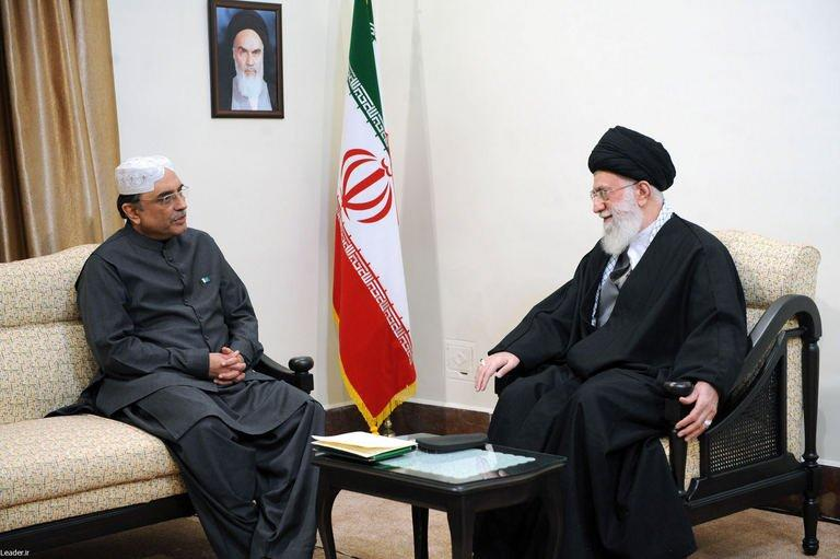 Iranian Supreme Leader Ayatollah Ali Khamenei (R) talks with Pakistan's President Asif Ali Zardari on February 27, 2013