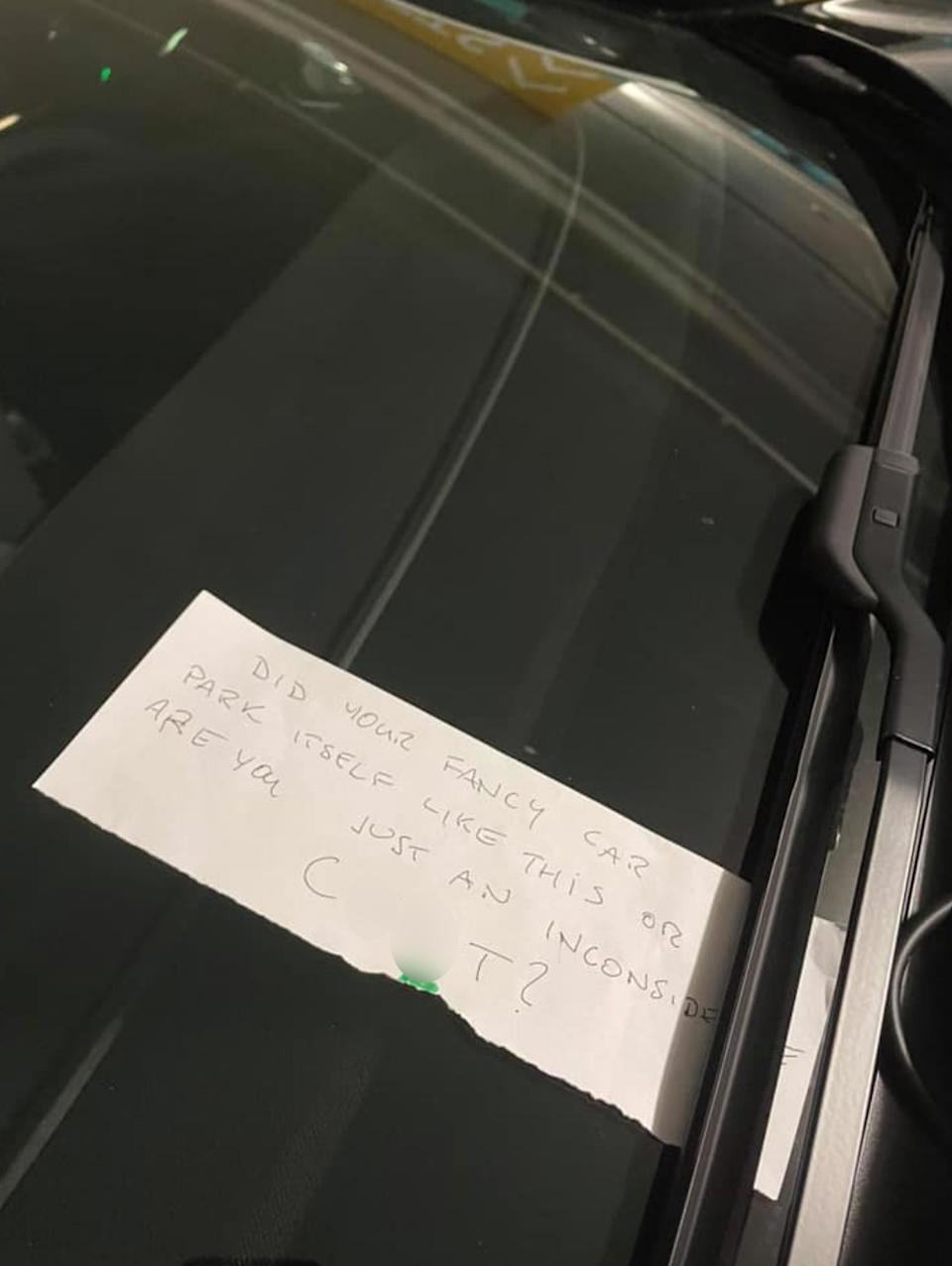 An unimpressed passerby left this nasty note for the driver of the Tesla. Source: Facebook
