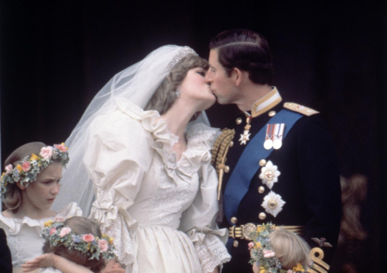 <p>Over 100 million people worldwide tuned in for the fairytale wedding of Charles, Prince of Wales, and Lady Diana Spencer on July 29, 1981. After the ceremony, the couple delighted onlookers by sharing a spontaneous smooch. <i>[Photo: Rex/Reginald Davis]</i><br /></p>