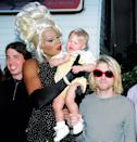 <p>Drag superstar Ru Paul holding Kurt Cobain's baby Frances Bean Cobain. Cobain was an outspoken and prominent supporter of LGBTQ rights and acceptance.</p>