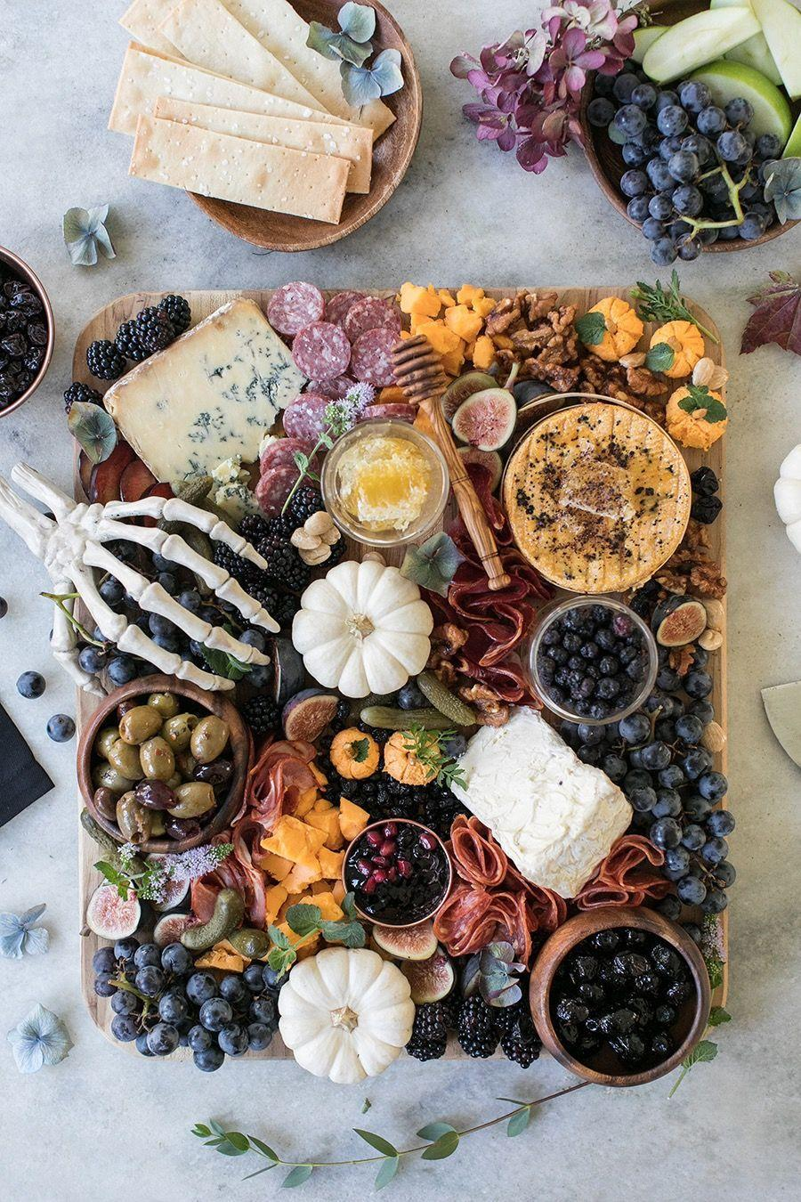 """<p>This elegant board highlights the colors of fall, with fun details like the skeleton hand for Halloween flair. It's perfect for a sophisticated Halloween dinner party or romantic evening in.</p><p><a class=""""link rapid-noclick-resp"""" href=""""https://sugarandcharm.com/how-to-make-the-perfect-halloween-meat-and-cheese-board"""" rel=""""nofollow noopener"""" target=""""_blank"""" data-ylk=""""slk:GET THE RECIPE"""">GET THE RECIPE</a></p>"""