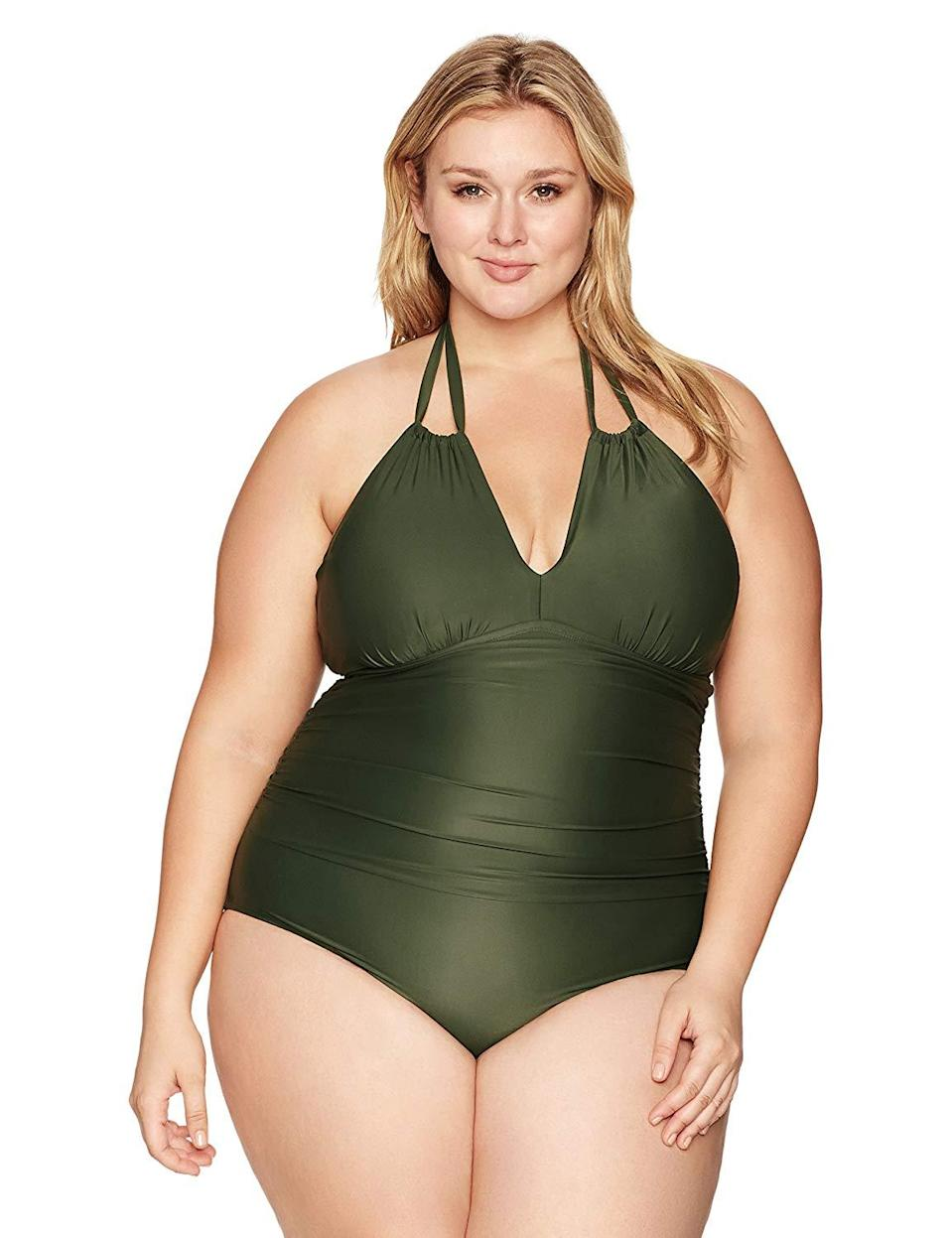 """<h2>Coastal Blue<br></h2><br>""""I love this bathing suit. I am very chesty and the bathing suit covers most of my chest with a little sexy side boob cleavage,"""" explained one reviewer of this almost 4-star reviewed maillot. """"I never felt confident in a bathing suit, but I do in this one. I won't be wearing any cover-ups.""""<br><br><strong>Coastal Blue</strong> Plus Size One Piece Swimsuit, $, available at <a href=""""https://www.amazon.com/Coastal-Blue-Strappy-Swimsuit-Roaring/dp/B06W2PHQQJ/ref=sr_1_13"""" rel=""""nofollow noopener"""" target=""""_blank"""" data-ylk=""""slk:Amazon"""" class=""""link rapid-noclick-resp"""">Amazon</a>"""