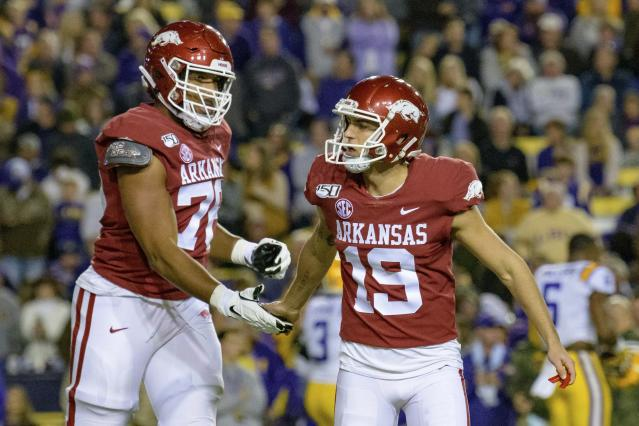 Arkansas' Connor Limpert (19) is congratulated for his field goal against LSU by offensive lineman Myron Cunningham (76) during the first half of an NCAA college football game in Baton Rouge, La., Saturday, Nov. 23, 2019. (AP Photo/Matthew Hinton)