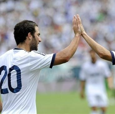 Real Madrid's Jose Maria Callejon, right, celebrates with Gonzalo Higuain after a goal in the first half of a soccer game against Glasgow Celtic Saturday, Aug. 11, 2012, in Philadelphia. (AP Photo/Michael Perez)
