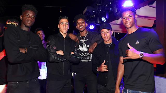 <p>Manchester United players Axel Tuanzebe, Joel Castro Pereira, Jesse Lingard and Marcus Rashford sandwich the NBA's Nick Young.</p>