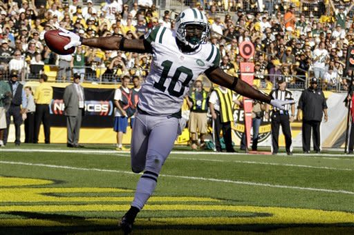 New York Jets wide receiver Santonio Holmes (10) celebrates as he runs through the end zone after catching a pass for touchdown in the first quarter of an NFL football game against the Pittsburgh Steelers in Pittsburgh, Sunday, Sept. 16, 2012. (AP Photo/Gene J. Puskar)