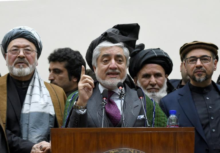 """Abdullah Abdullah, who serves as Afghanistan's """"chief executive"""" under Ghani, takes part in a press conference following release of the election results"""