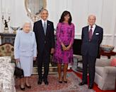 <p>In England for Queen Elizabeth II's 90th birthday, President Obama and and his wife, Michelle Obama, were invited to dine with Her Majesty and Prince Phillip for the special occasion. Perhaps as a nod to the royals, the first lady wore a fuchsia and regal purple dress from Oscar de la Renta. <i>Photo: AP</i></p>