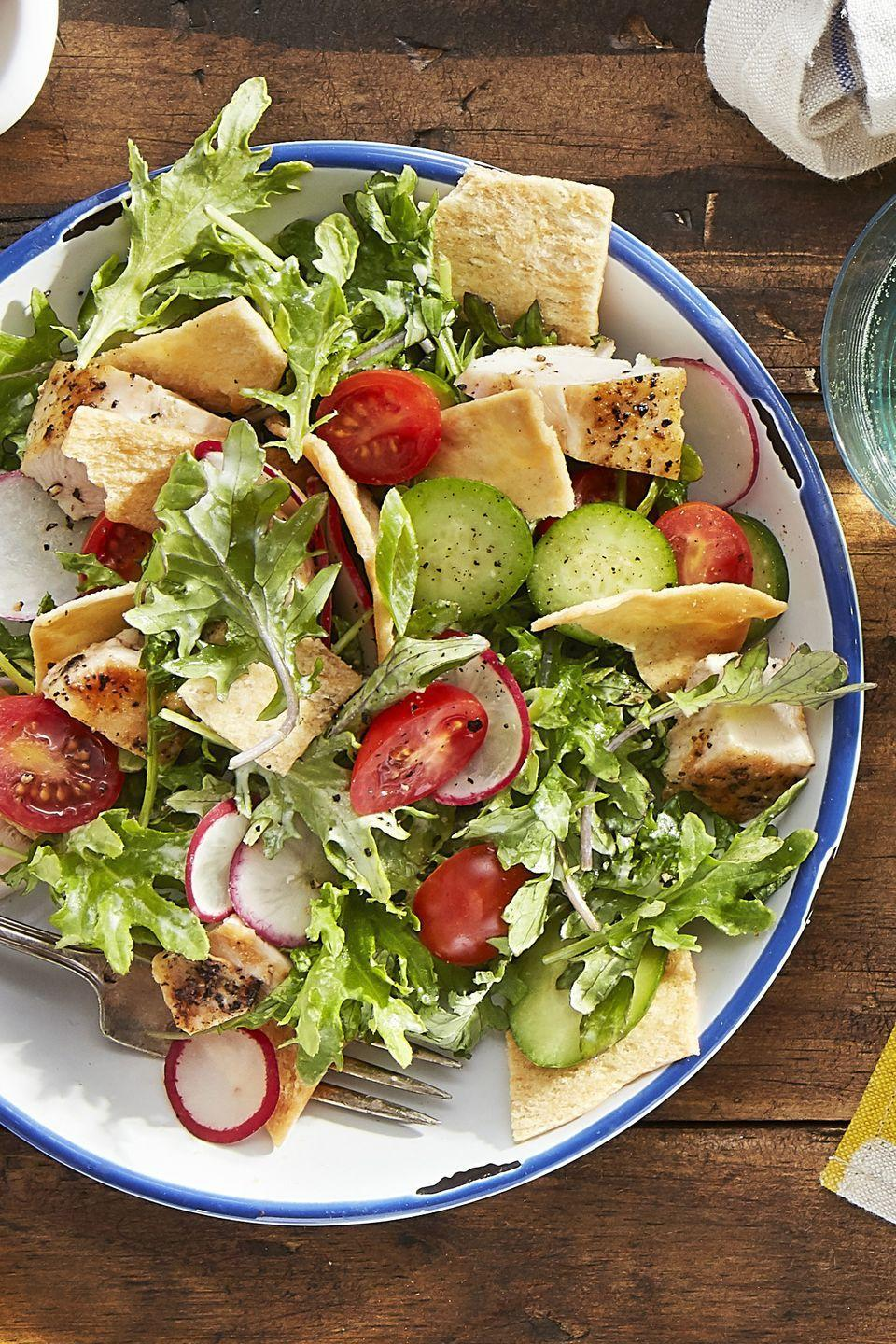 """<p>Cucumbers and radishes bring crunch <em>and </em>color to this baby kale salad.</p><p><strong><a href=""""https://www.countryliving.com/food-drinks/recipes/a44243/kale-chicken-pita-salad-recipe/"""" rel=""""nofollow noopener"""" target=""""_blank"""" data-ylk=""""slk:Get the recipe"""" class=""""link rapid-noclick-resp"""">Get the recipe</a>.</strong></p>"""