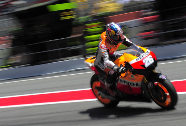 Repsol Honda Team's Spanish Dani Pedrosa leaves the pits of the Catalunya racetrack in Montmelo, near Barcelona, on June 1, 2012, during the MotoGP second training session of the Catalunya Moto GP Grand Prix. AFP PHOTO / JOSEP LAGOJOSEP LAGO/AFP/GettyImages
