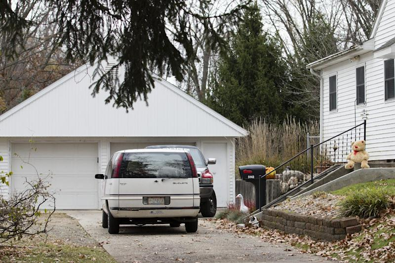A lone teddy bear sits on the steps of the home in Toledo, Ohio, Tuesday Nov. 13, 2012. Three children, their uncle, and their grandmother were found dead inside the garage at the house Monday in what appears to be a murder-suicide amid a custody dispute. (AP Photo/Rick Osentoski)