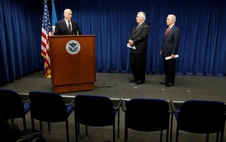 Homeland Security Secretary John Kelly (L), Secretary of State Rex Tillerson (C) and Attorney General Jeff Sessions (R), deliver remarks on issues related to visas and travel after U.S. President Donald Trump signed a new travel ban order in Washington, U.S., March 6, 2017. REUTERS/Kevin Lamarque