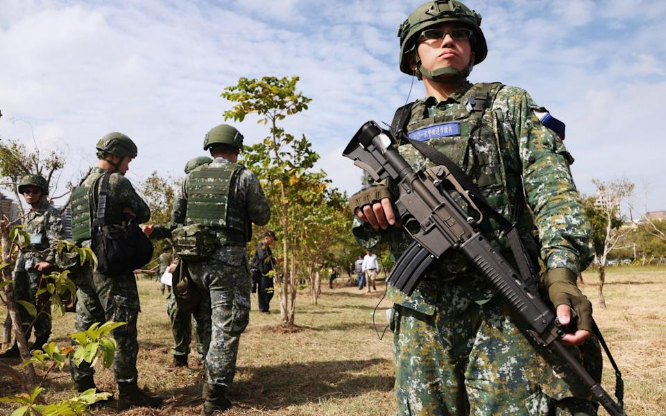 A Taiwanese soldier stands guard during a drill - Ann Wang/Reuters