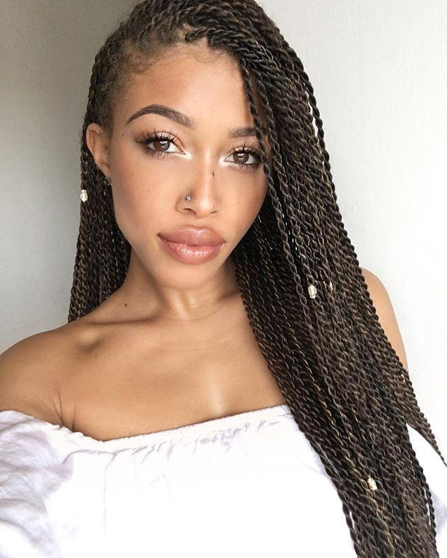 "<p>Don't want to do regular ol' black twists? <strong>Choose a dark brown shade instead for your Senegalese twists to mix things up. </strong>Keep your parts slick and smooth by using a <a href=""https://www.amazon.com/Eco-Style-Styling-Olive-Ounce/dp/B00AOL7RRY/ref=sr_1_14?linkCode=ogi&tag=cosmopolitan_auto-append-20&ascsubtag=[artid