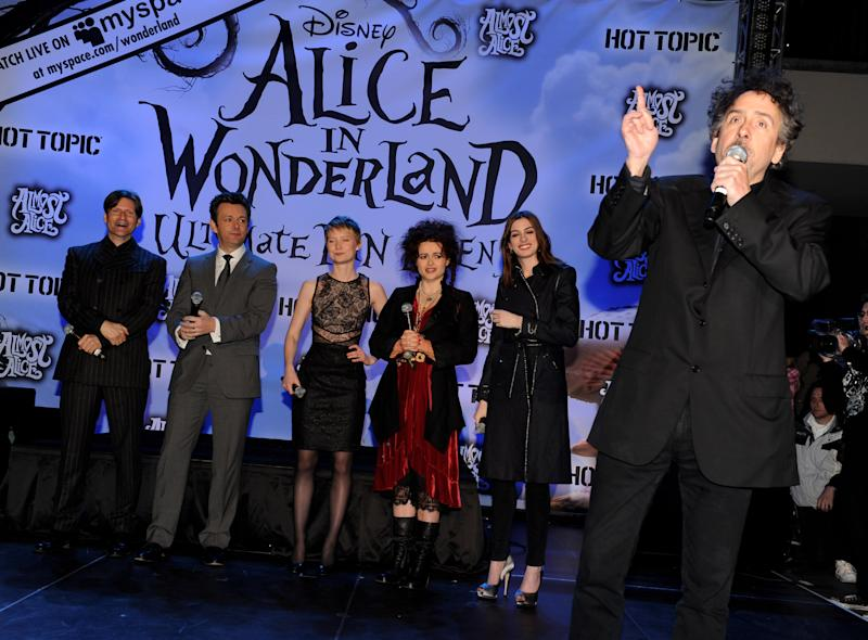 "(L-R) Crispin Glover, Michael Sheen, Mia Wasikowska, Helena Bonham Carter, Anne Hathaway and Tim Burton appear onstage ""Alice in Wonderland"" fan event on February 19, 2010 in Los Angeles, California"