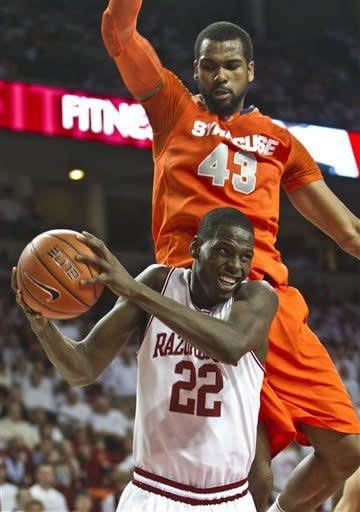 Arkansas' Jacorey Williams (22) pulls in a rebound as Syracuse's James Southerland (43) defends during the second half of an NCAA college basketball game in Fayetteville, Ark., Friday, Nov. 30, 2012. Syracuse defeated Arkansas 91-82. (AP Photo/Gareth Patterson)