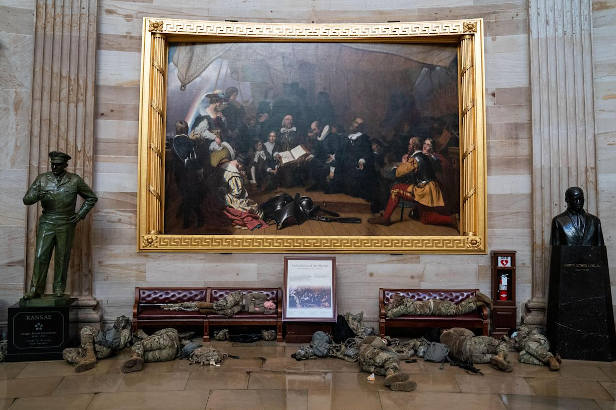 Members of the National Guard sleep in the rotunda of the Capitol