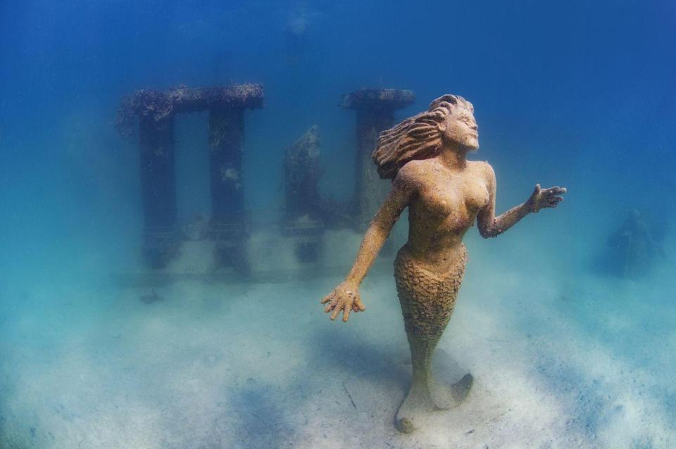 """<p>This bronze <a href=""""http://mermaidsofearth.com/who-was-amphitrite-and-why-is-her-statue-off-grand-cayman-island/"""" rel=""""nofollow noopener"""" target=""""_blank"""" data-ylk=""""slk:statue of Amphitrite"""" class=""""link rapid-noclick-resp"""">statue of Amphitrite</a>, wife of Poseidon, can be found in the Caribbean Sea, off the coast of Grand Cayman Island. The 9-foot tall, 600-pound statue was erected in 2000.</p>"""