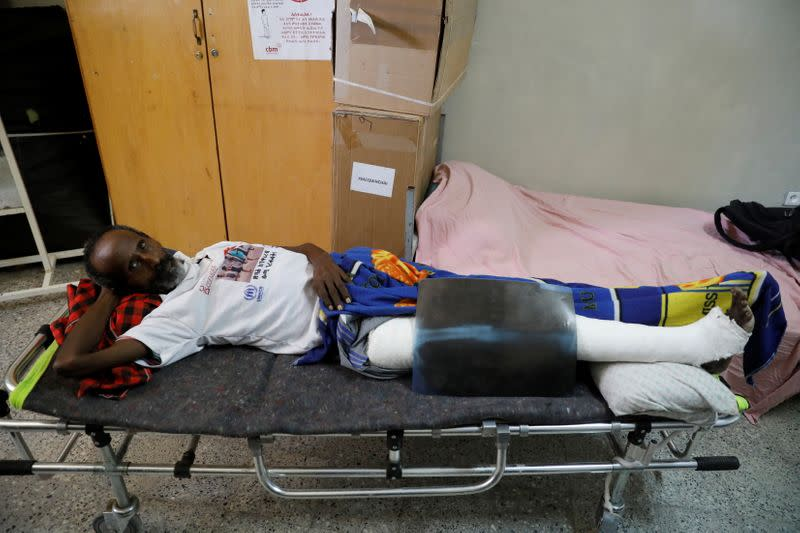 Berhane Gebrezigher, who says he is one of the few survivors of a mass killing at the Tekeze River in January 2021, is seen at the Suhul General Hospital, in the town of Shire, Tigray region