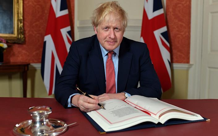 Boris Johnson signs the Withdrawal Agreement -  Andrew Parsons/Number 10 Downing Street