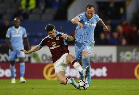 Britain Football Soccer - Burnley v Stoke City - Premier League - Turf Moor - 4/4/17 Burnley's Joey Barton in action with Stoke City's Charlie Adam Reuters / Phil Noble Livepic