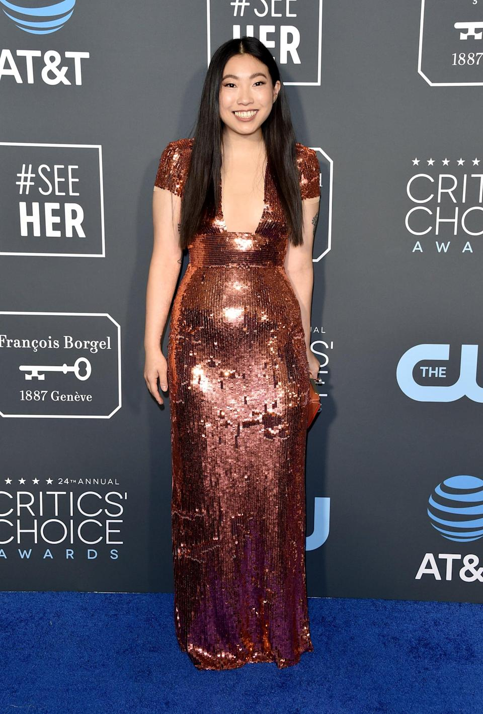 <p>Awkwafina wearing a sequined Elisabetta Franchi gown and Christian Louboutin heels.</p>
