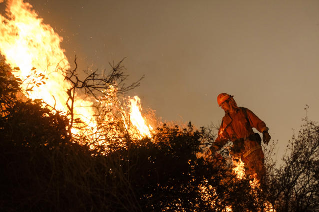 <p>A firefighter sets a backburn to fight the Holy Fire as it burns in the Cleveland National Forest along a hillside at Temescal Valley in Corona, Calif., Thursday, Aug. 9, 2018. (Photo: Ringo H.W. Chiu/AP) </p>