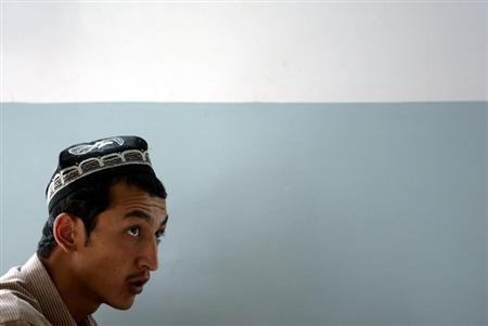 UIGHUR STUDENT ATTENDS CLASS AT MEDICAL COLLEGE IN HOTAN.