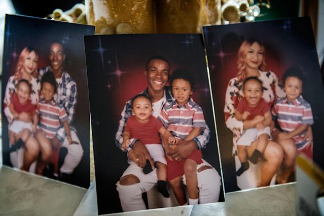 <p>Pictures showing Stephon Clark and his wife, Salena Manni, and sons Aiden Clark, 3, and Cairo Clark, 1, rested on a table inside his grandmother Sequita Thompson's home in Sacramento, Calif., on March 20, 2018. (Photo: Renée C. Byer/The Sacramento Bee via ZUMA Press). </p>