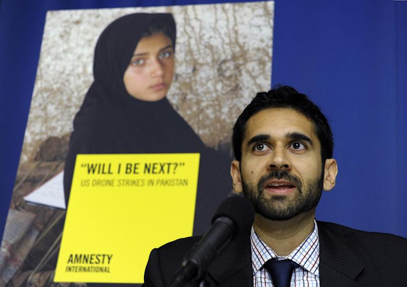 Mustafa Qadri, a Pakistan researcher at Amnesty International, talks about the findings of two new reports, by Amnesty International and Human Rights Watch on US drone strikes and other air strikes in Pakistan and Yemen, Tuesday, Oct. 22, 2013, during a news conference at the National Press Club in Washington. (AP Photo/Susan Walsh)