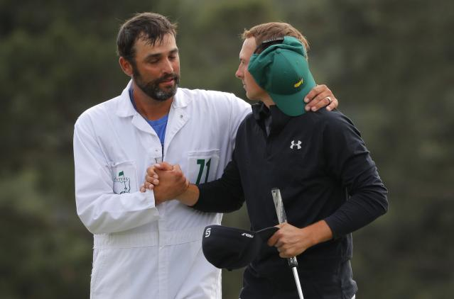 Jordan Spieth of the U.S. and his caddie Michael Greller embrace after finishing on the 18th green during final round play of the 2018 Masters golf tournament at the Augusta National Golf Club in Augusta, Georgia, U.S. April 8, 2018. REUTERS/Brian Snyder