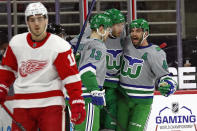 Carolina Hurricanes' Jordan Staal (11), center, is congratulated on his goal by teammates Warren Foegele (13) and Jordan Martinook (48) during the first period of an NHL hockey game against the Detroit Red Wings in Raleigh, N.C., Saturday, April 10, 2021. (AP Photo/Karl B DeBlaker)