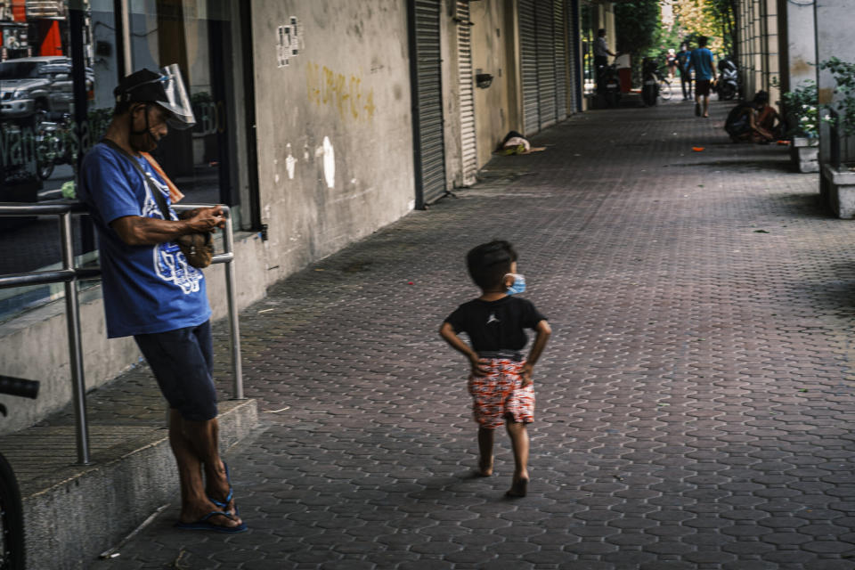 A boy in Manila's downtown district. Photo: Luis Liwanag