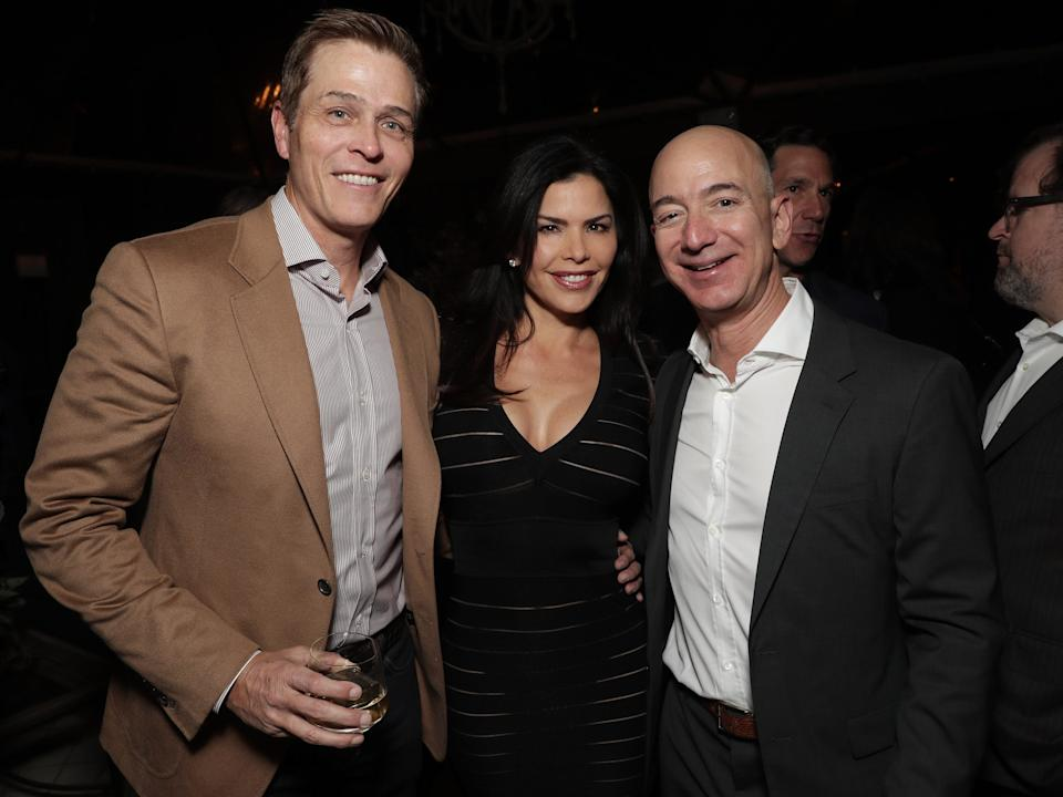"""Jeff Bezos, right, with Lauren Sanchez and her then-husband, Patrick Whitesell. <p class=""""copyright"""">Todd Williamson/Getty Images for Amazon Studios</p>"""