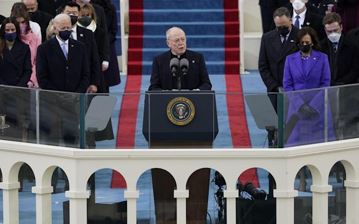 Father Leo O'Donovan delivers the invocation as President-elect Joe Biden, left, and Vice President-elect Kamala Harris look on during the inauguration of Joe Biden as US President in Washington, DC, USA, 20 January 2021. Biden won the 03 November 2020 election to become the 46th President of the United States of America - EPA