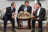 In this photo released by the official website of the Iranian Presidency Office, U.N. Secretary-General Ban Ki-Moon, left, talks with Iranian President Mahmoud Ahmadinejad, right, during their meeting in Tehran, Iran, Wednesday, Aug. 29, 2012. An unidentified interpreter sits at center. (AP Photo/Presidency Office, Mohsen Rafinejad)