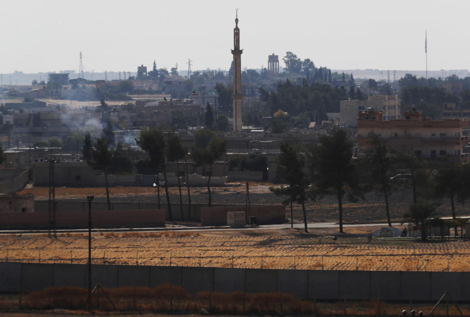 In this photo taken from the Turkish side of the border between Turkey and Syria, in Akcakale, Sanliurfa province, southeastern Turkey, a view of the town of Tal Abyad, Syria, Wednesday, Oct. 23, 2019. Russian media reports say Russian military police have started patrols in northern Syria as a Turkish-Russian agreement giving Syrian Kurdish fighters 150 hours to withdraw from almost the entire northeast border region of Syria came into effect. (AP Photo/Lefteris Pitarakis)