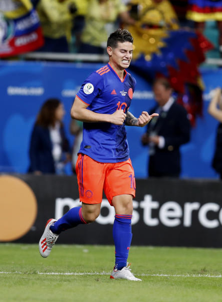 Colombia's James Rodriguez celebrates the second goal scored by Colombia's Duvan Zapata during a Copa America Group B soccer match against Argentina at the Arena Fonte Nova in Salvador, Brazil, Saturday, June 15, 2019. (AP Photo/Natacha Pisarenko)